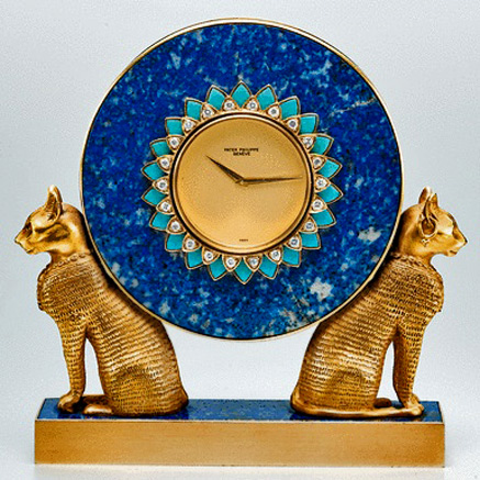 PATEK-PHILIPPE,-A-FINE-AND-UNIQUE-GOLD,-LAPIS-LAZULI,-TURQUOISE-AND-DIAMOND-SET-MINIATURE-EGYPTIAN-STYLE-TABLE-CLOCK-with twin cats 1978-