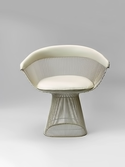 PKO, chair designed by Poul Kjaerholm -- modernist-mid-century chair white vinyl upholsery and chrome wire frame Mid century chair