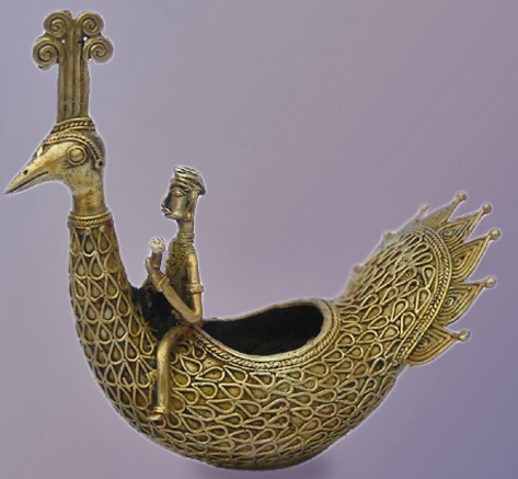 Dhokra metal sculpture - man sitting on a peacock