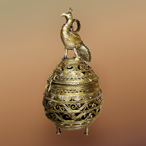 Tri legged lidded Dhokra vessel with peacock lid
