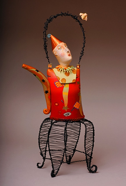 Hope-Warmed-Over Laura-Balombini-----mixed media artist -red teapot with clown head lid