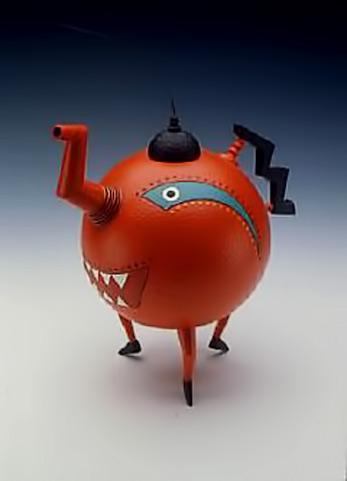 Michael-Hosaluk-- tri legged teapot in rusty orange with black lid and handle