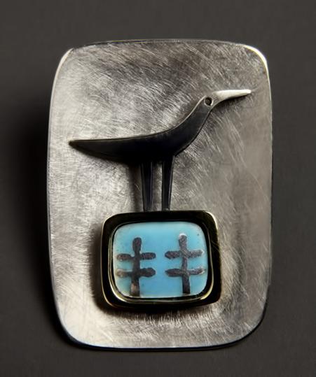 Alan Ardiff,-Irish-jeweller.-One Fine Day -brushed metal brooch with bird motif