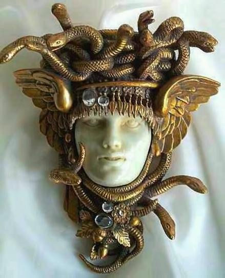 Head-of-the-Gorgon-MedusaLate-19th-Century-Czechoslovakian-brooch,-gold,-jasper,-and-crystal