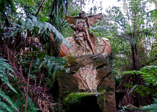 William Ricketts rock sculpture in a fern forest