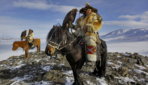 Epic-Kazakh Golden Eagle hunters- on horseback on the steppes