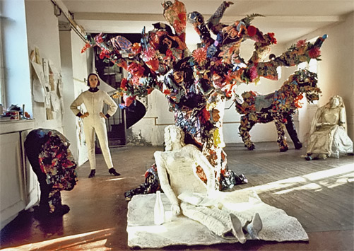 Home---Niki-Charitable-Art-Foundation-Niki-de-Saint-Phalle-in-her-studio-at-Soisy,-surrounded-by-Le-Mangeur--d'Enfants,-La-Mariée-sous-l'Arbre,-and-Le-Cheval-et-la-Mariée