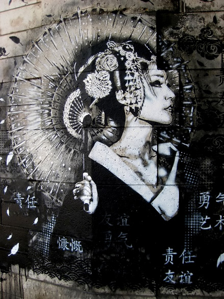 Street-art-by-Fin-Dac---such-delicacy-on-a-completely-non-accomodating-canvas...