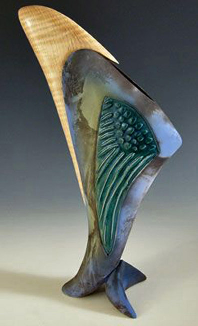Clay-sculpture-and-mirrors-with-wood-accents-by-Jan-Jacque
