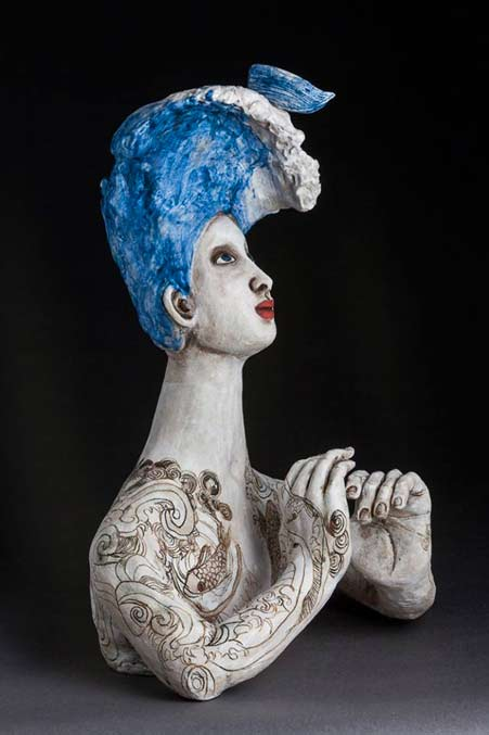 Over-the-edge-2014Amanda-Shelser Bust of a lady with blue hair and tattoos