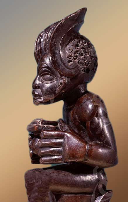 Chief-holding-a-sanza,-a-musical-instrument-of-the-ideophone-family,-with-metal-keys-and-gourd-resonator