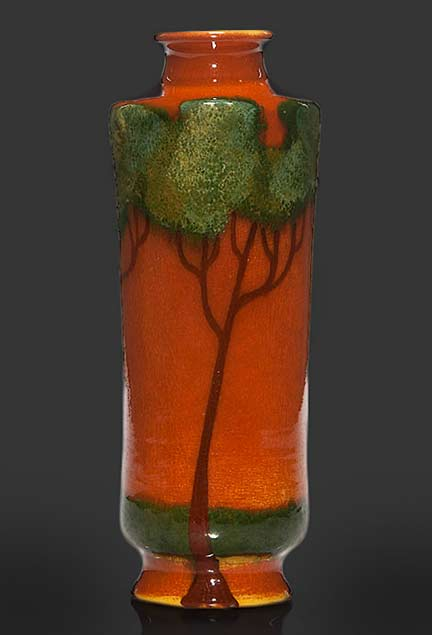 Humler-and-Nolan-Weller-Faience-vase,-Rhead-like-trees, in orange and green