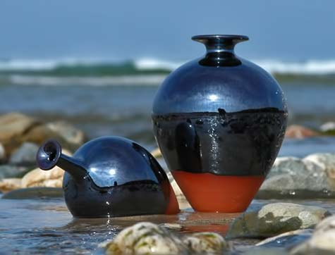 Russell-Akerman-black-bottles at the beach
