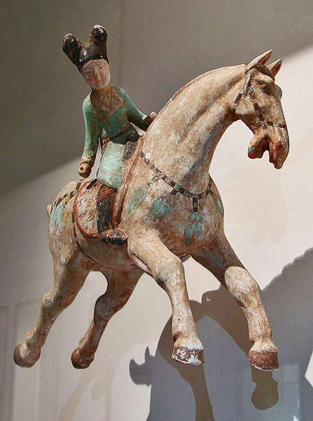 Tang-sculpture of a woman-playing-polo on a horse