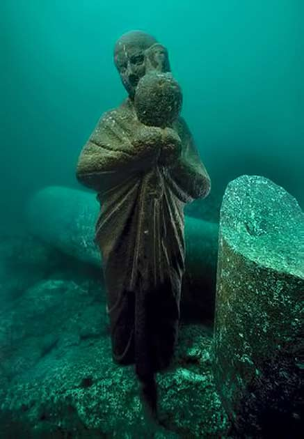 The-statue-of-an-Isis-priest-holding-an-Osiris-jar-found-on-the-sunken-Island-of-Antirhodos-in-the-great-harbour-of-Alexandria