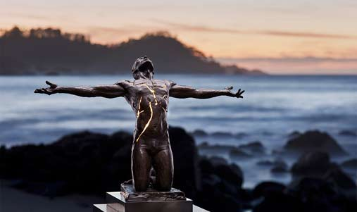 Illumination-Paige Bradley sculpture of a kneeling man with his arms outstretched
