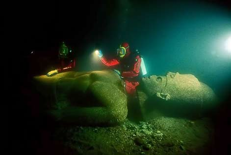 lost egypt excavation by divers of monumental Egyptian statue