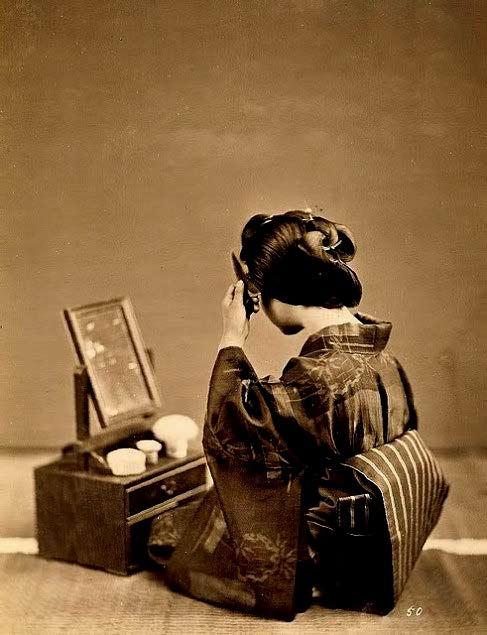 Vintage photo of a Geisha preparing hair