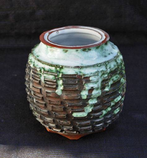 Andreas-Rauch - carved and incised vase with glazed top and terracotta base