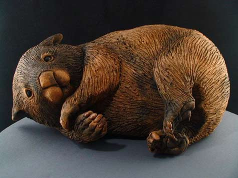 Chris-Stubbs resting wombat sculpture with incised ceramic surface