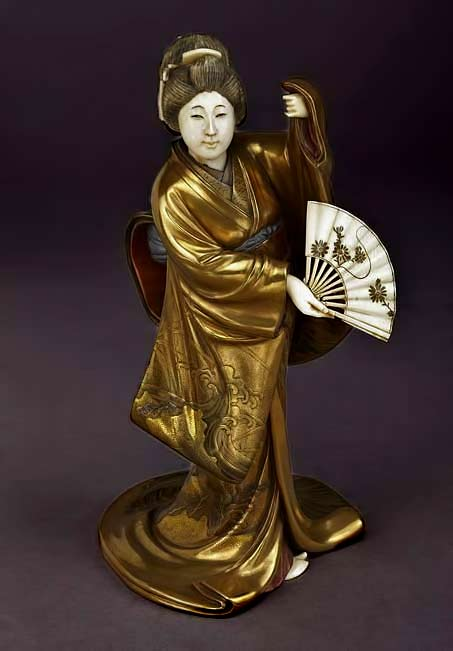 Golden Geisha-dancing-with-a-fan.-National-Library-of-France,-Public-Domain