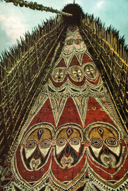 Spectral-gallery-of-spirit-faces-peers-from-the-upper-facades-of-haus-tambarans-in-the-Maprik-area-stoneage-cathederals