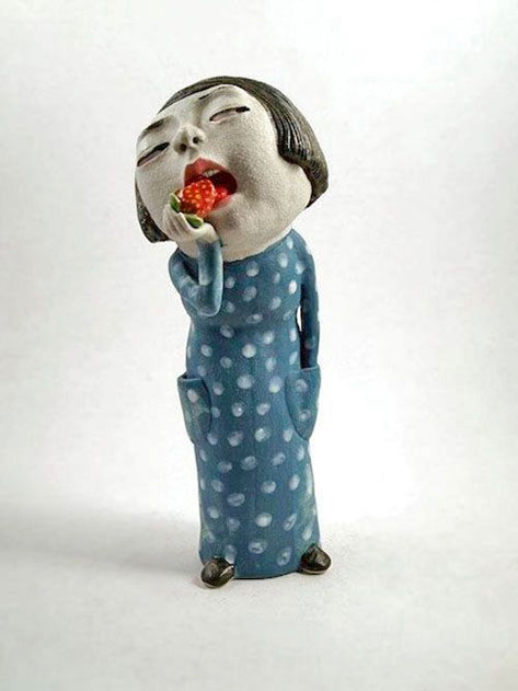 Dai-Li=ceramic figurine of a Chinese girl eating a strawberry