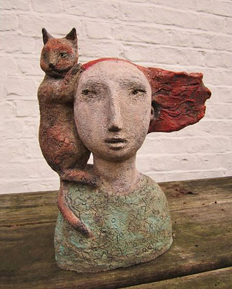 Frances-Baruch - textured ceramic bust of a red haired woman with a cat on her shoulder