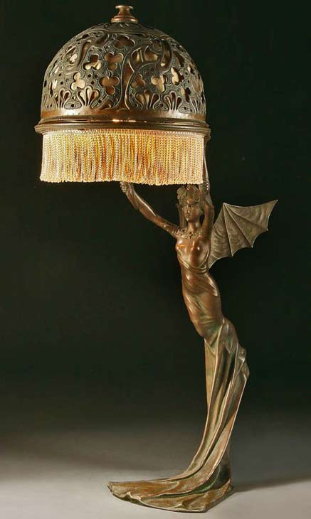AN-ART-NOUVEAU-BRONZED-METAL-FIGURAL-TABLE-LAMP-probably-Austrian-circa-1900-of-a-winged-nymph,-after-a-model-by-R