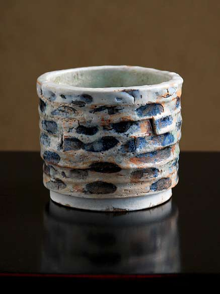 Adam Whatley Shino-Cup-Mendelssohn--Exterior has a very textured shino surface with heavily crawling glaze. Dark areas of iron oxide and manganese.