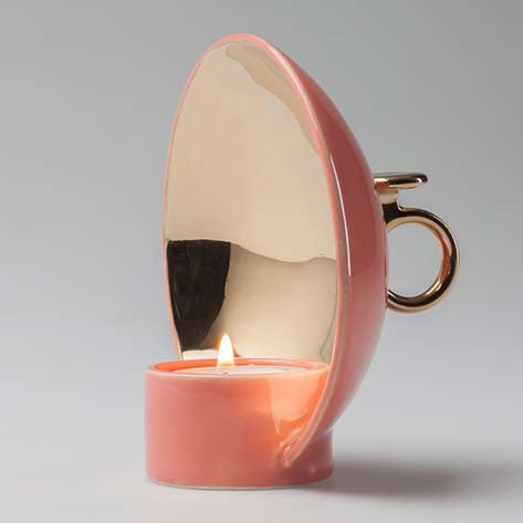 Salmon-pink-candleholder-with-gold-details-called-lume-by-alessandro-zambelli-looks-like-a-satellite-dish