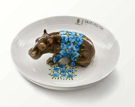 hand-painted-ceramic-bowls-filled-with-detailed-hippos-foxes-and-deer