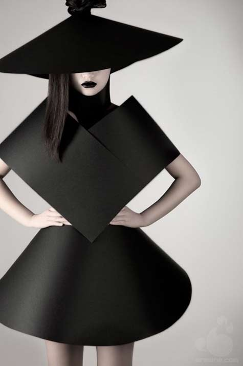 suprematism-ii-by-olga-zavershinskaya - model wearing a black geometrical dress and hat
