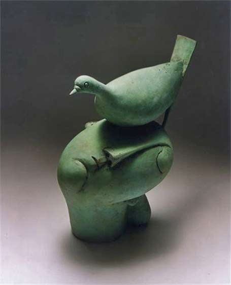 mourning-dove-by-peter-harskamp - green bird sitting on a mans head