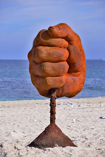 norton-flavel-dust-sculpture-by-the-sea-cottesloe-2016 large red fist holding dust