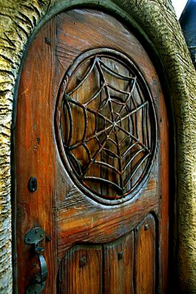 The outside spider web motif gate at Witches House in Beverly Hills.