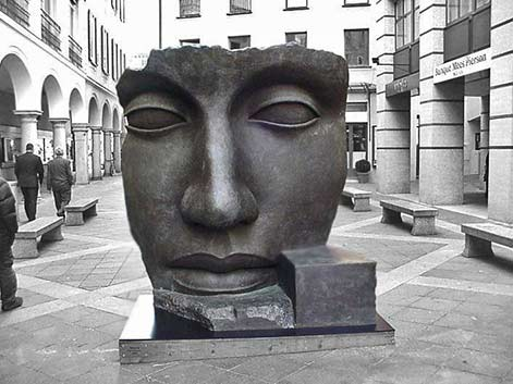 igor_mitoraj_ street sculpture of a large face