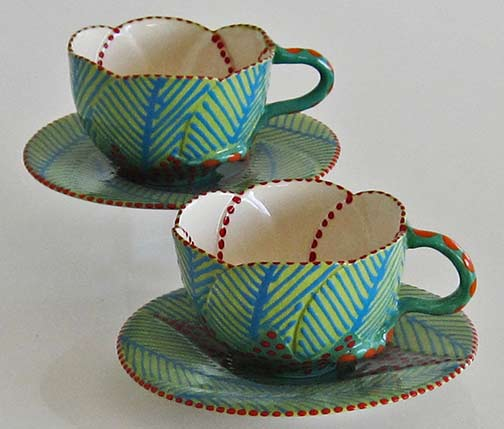 potterseed-leaf motif cups and saucers