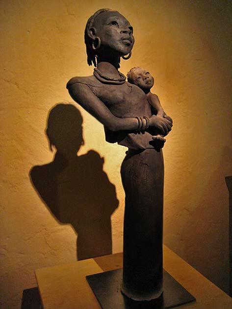 Michele-Ludwiczak African woman hoilding child sculpture