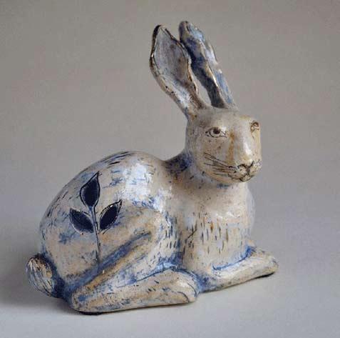 margaret-wozniak - blue highlights on a white ceramic rabbit