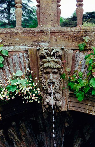 Hestercombe Gardens Arch Fountain - water running from a classical head sculpture