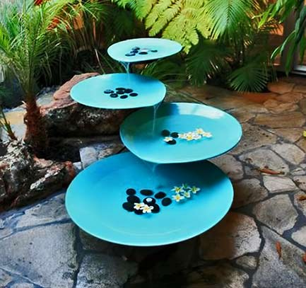turquoise fountain with cascading discs