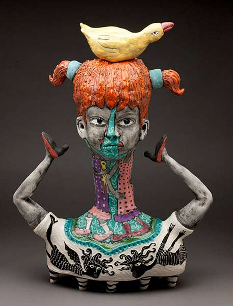 Red hair girl with duck nesting on her head sculpture --Laura-Jean-McLaughlin