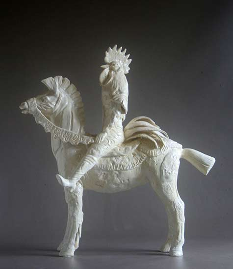 Sally White porcelain rooster riding a horse