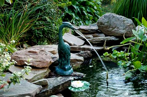Jade green heron fountain sculpture