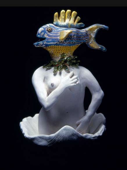 Carol-Gentithes-sculpture of a fish headed torso in a large sgell