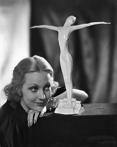 Ann-Sothern and white female figurine statue
