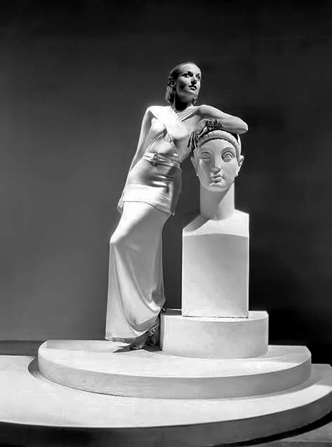 Carole lombard with winking greek bust sculpture