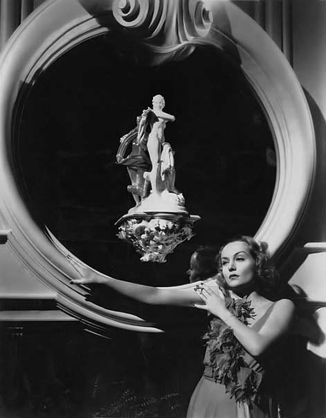 Carole-Lombard with nude figure sculpture
