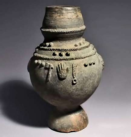Ritual pot with symbols from Ewe tribe in Togo